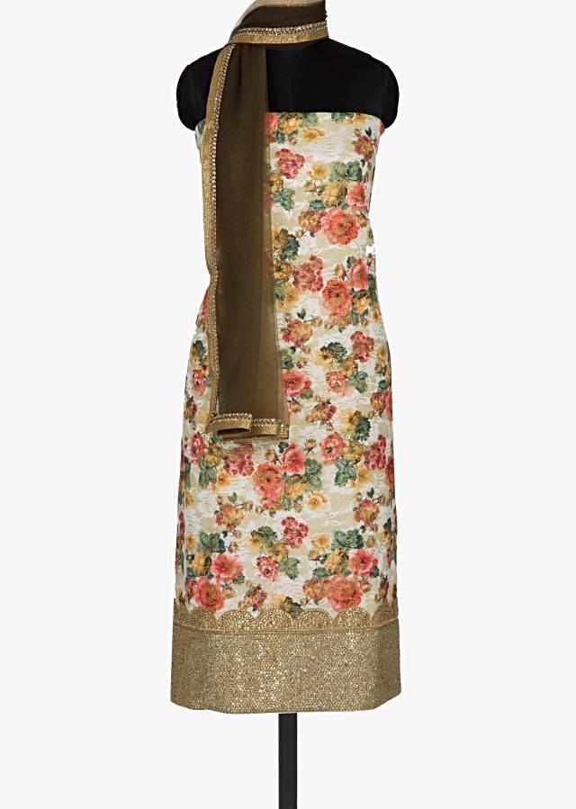 Cream Unstitched floral suit with shaded net dupatta only on Kalki