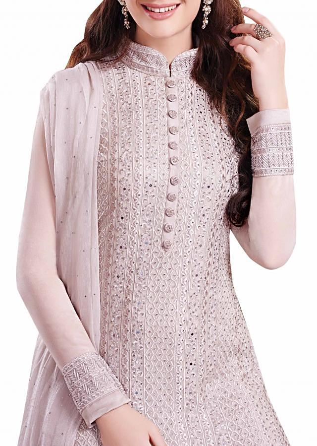 Cream unstitched suit adorn in resham and kundan embroidery