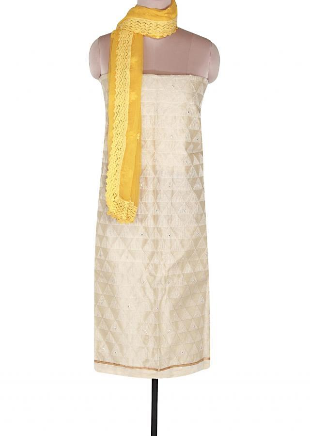 Cream unstitched suit embellished in resham embroidery only on Kalki