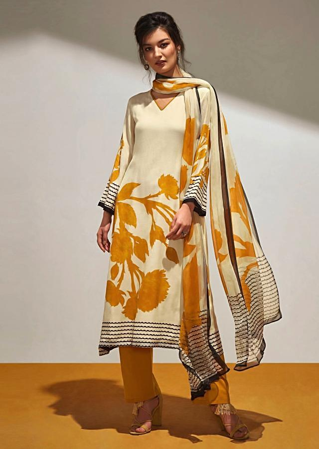 Cream unstithced suit with yellow floral print all overonly on Kalki