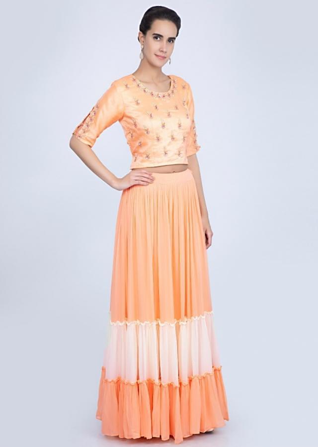 Creamish peach embroidered blouse with two shaded lehenga only on Kalki