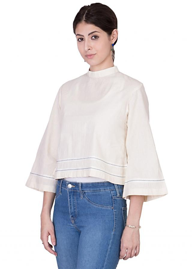 Crop top with closed band neckline and flared hemline and sleeves