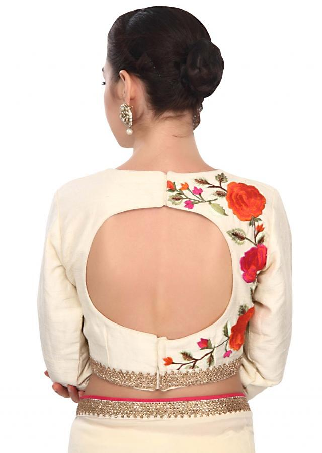 Curry cream blouse enhanced in resham in floral work only on Kalki