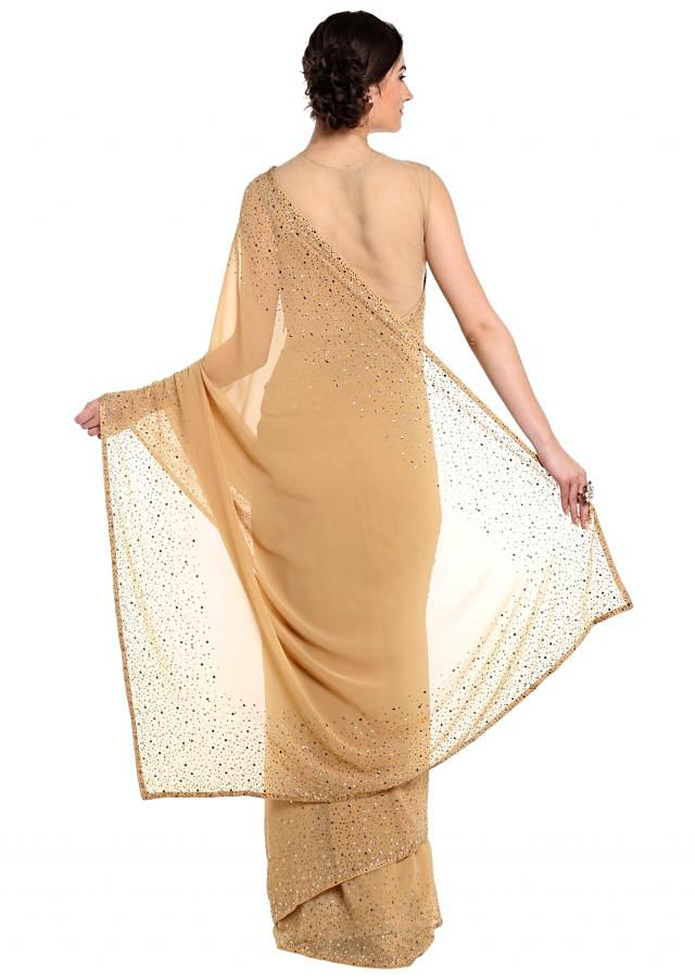 Dark beige saree adorn in gold and silver kundan embroidery only on Kalki