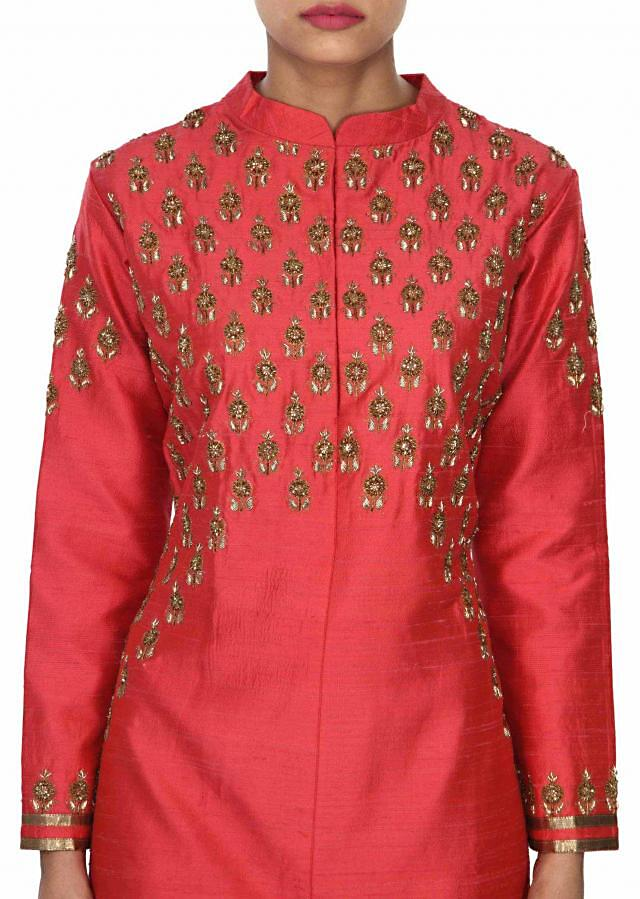 Dark coral kurti features with embellished butti only on Kalki