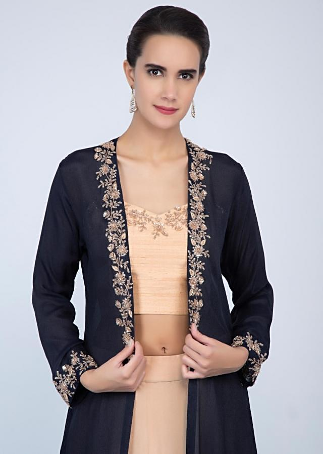 Dark cream crop top and skirt paired with contrasting navy blue jacket only on Kalki