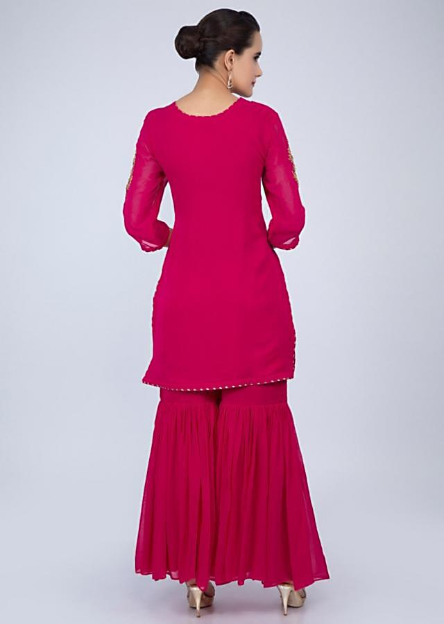 Dark fuchsia pink sharara suit with embroidery and butti only on Kalki