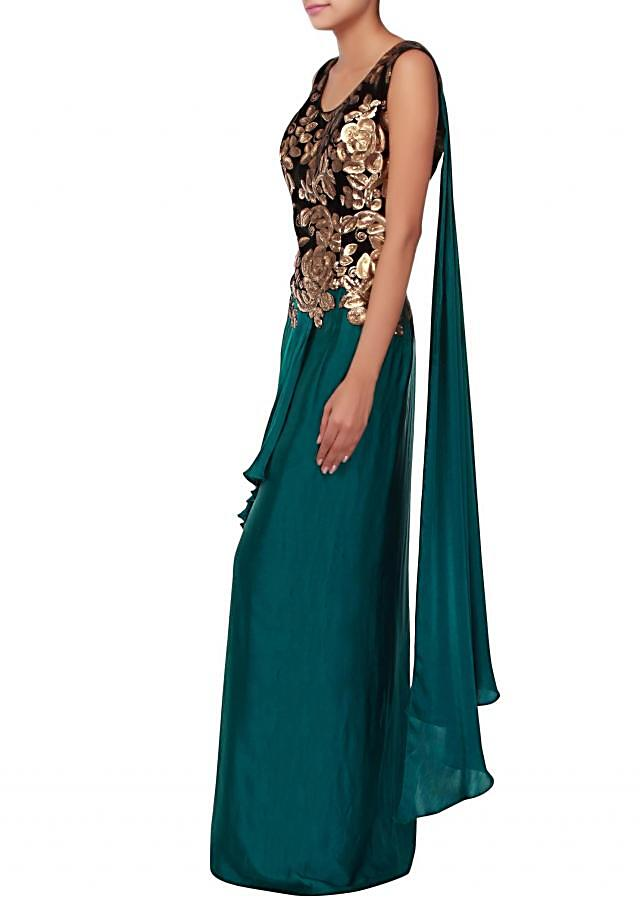 Dark green evening gown embellished in sequin and cascade drape only on Kalki