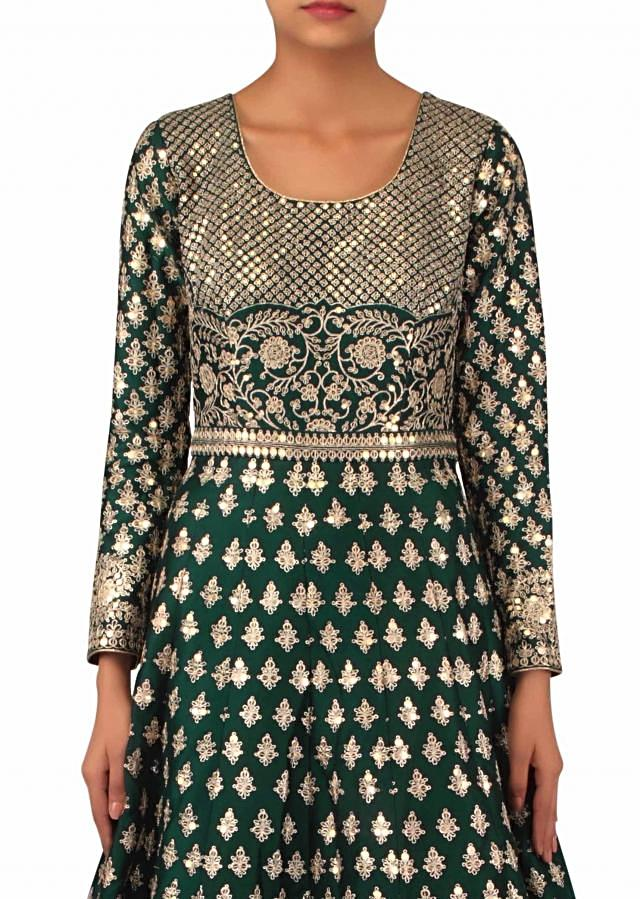 Dark green suit adorn in zari and sequin embroidery only on Kalki