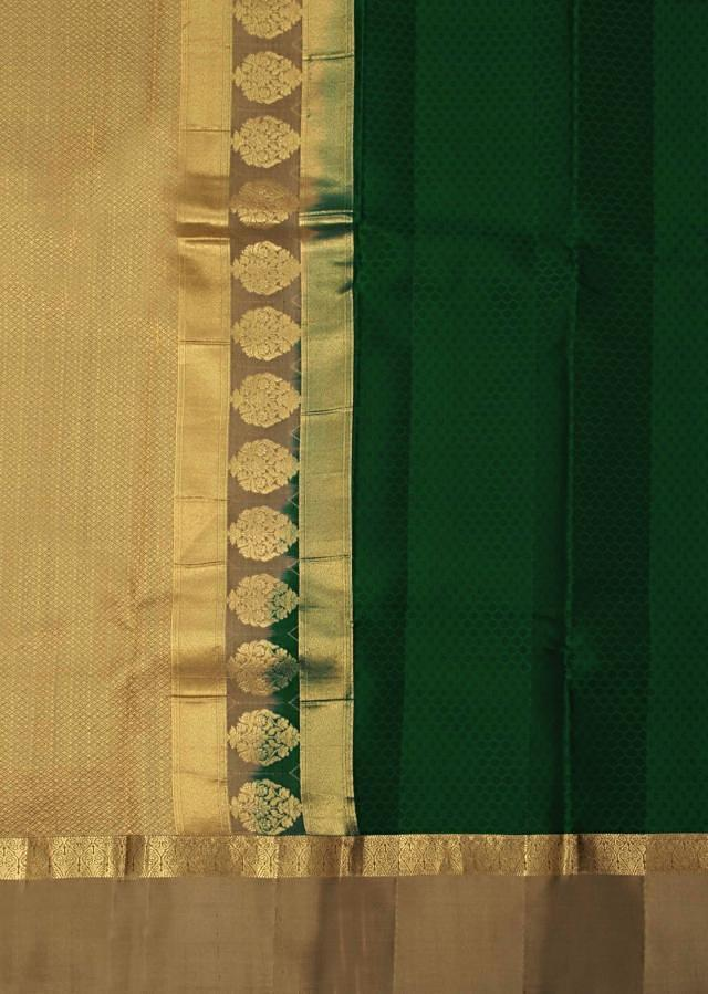 Dark green saree features with gold pallav and border only on Kalki