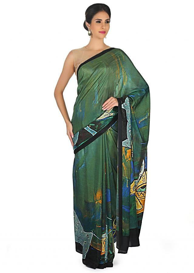 Dark green saree in abstract print with contrast border only on Kalki