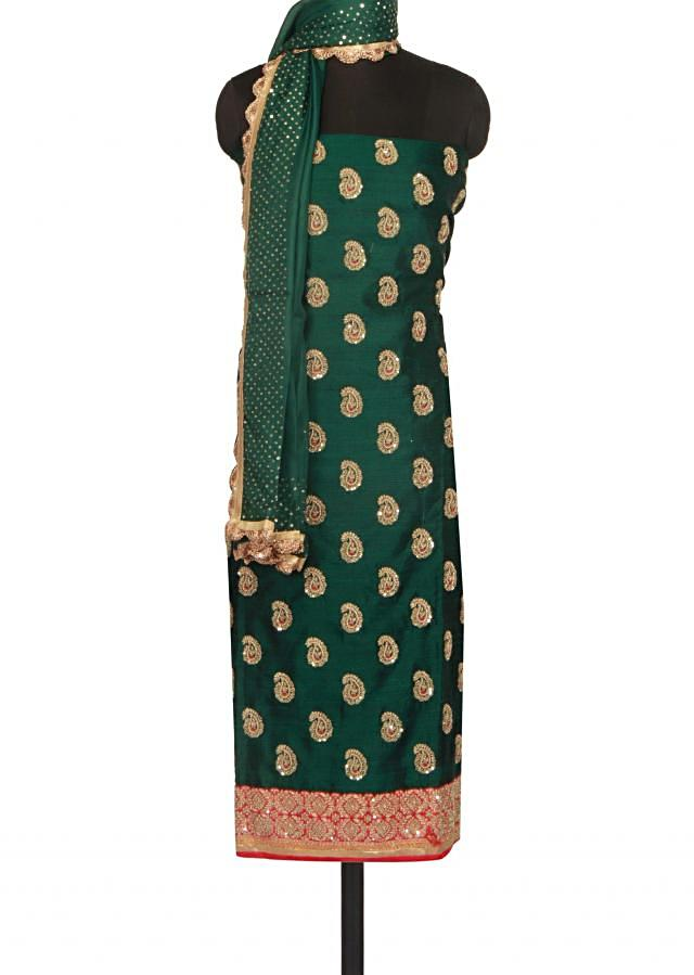 Dark green semi stitched suit in paisley motif embroidery only on Kalki