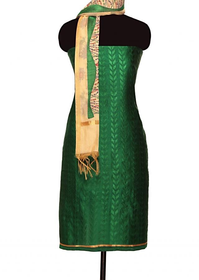 Dark green unstitched suit with beige embroidered dupattaonly on Kalki
