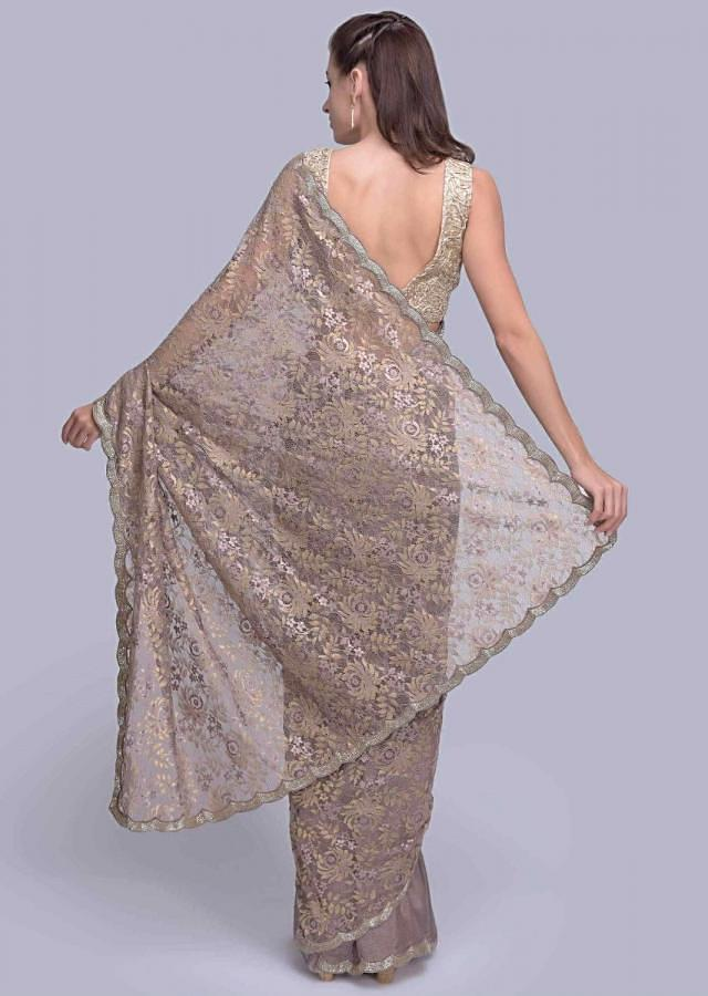 Dark lilac half and half saree with featuring in crepe chiffon and chantilly lace only on Kalki