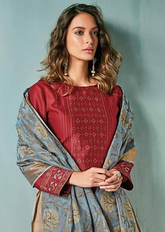 Dark maroon unstitched suit adorn in printed placket matched with  turq blue dupatta