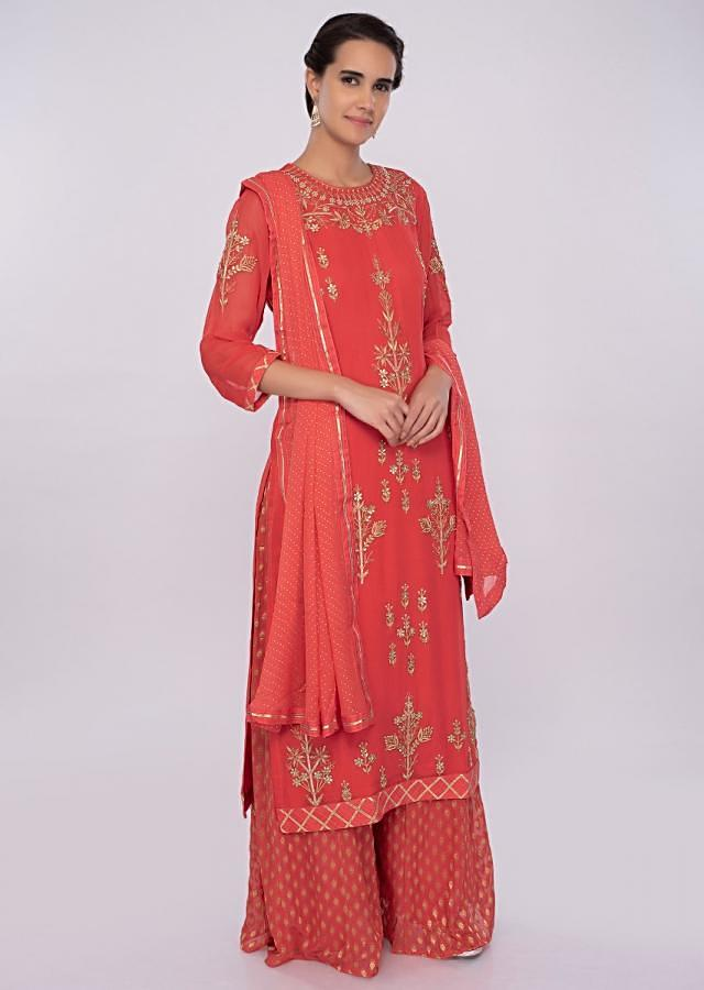 Dark peach georgette palazzo suit with embroidery and butti only on kalki