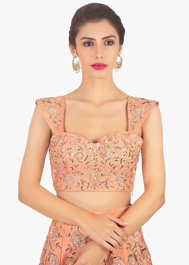 Dark peach lehenga set paired with a fancy net jacket only on Kalki