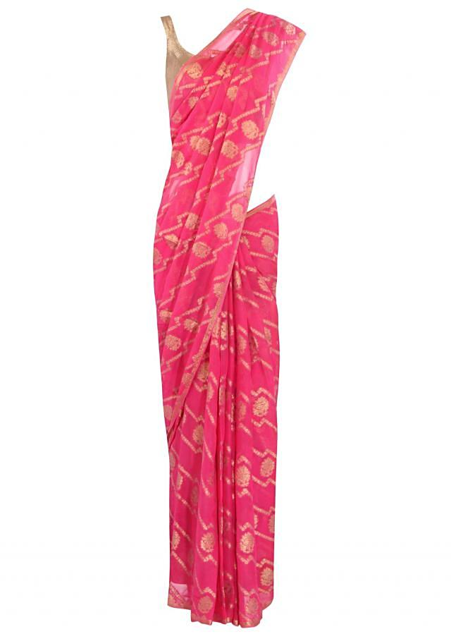 Dark pink saree adorn in weaved embroidery only on Kalki