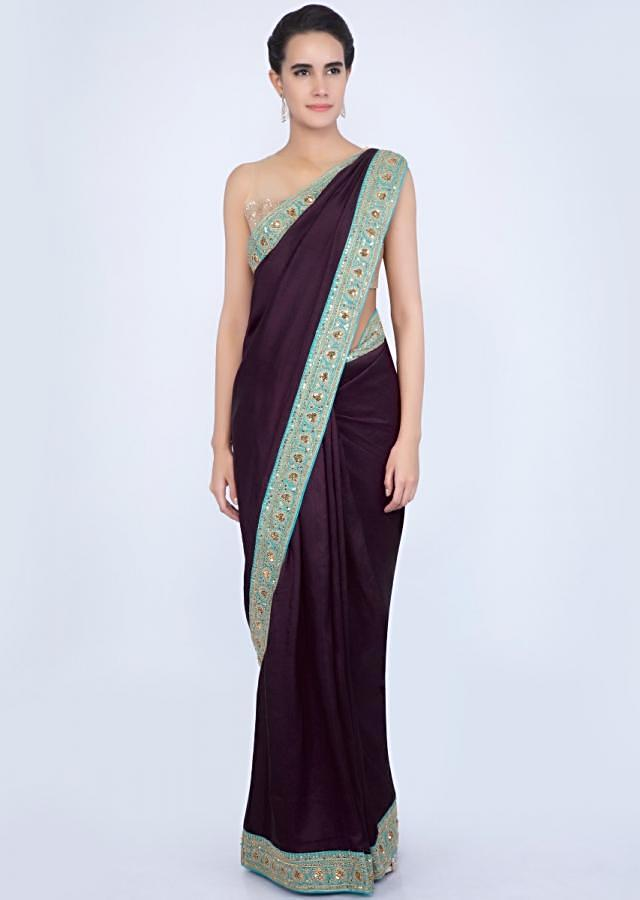 Dark plum silk saree with cord and sequins embroidered pallo and border only on Kalki