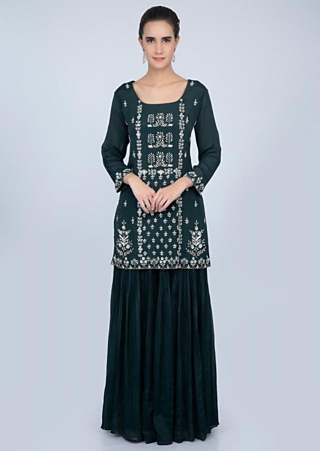 Dark teal blue embroidered suit with crushed palazzo and pink dupatta only on kalki