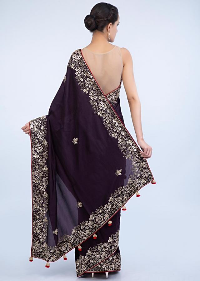 Dark violet saree with floral embroidered butti and border only on Kalki