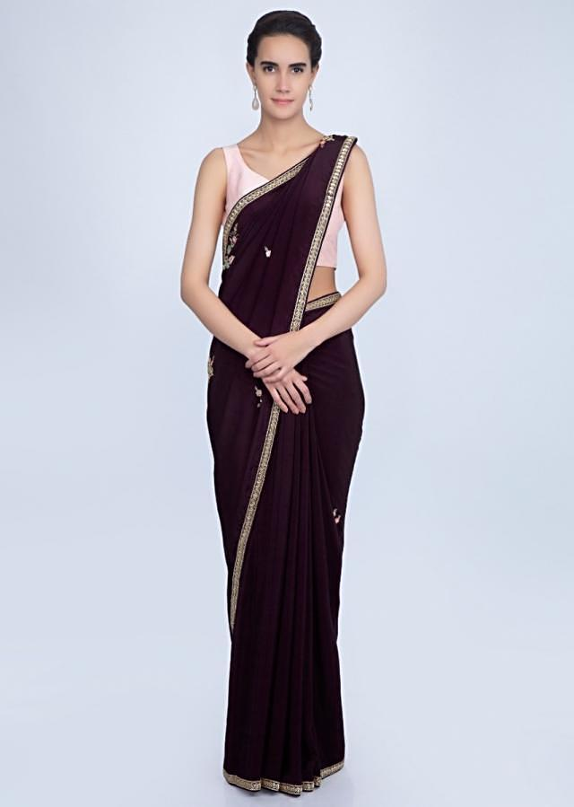 Dark violet satin crepe saree with embroidered butti and border only on Kalki
