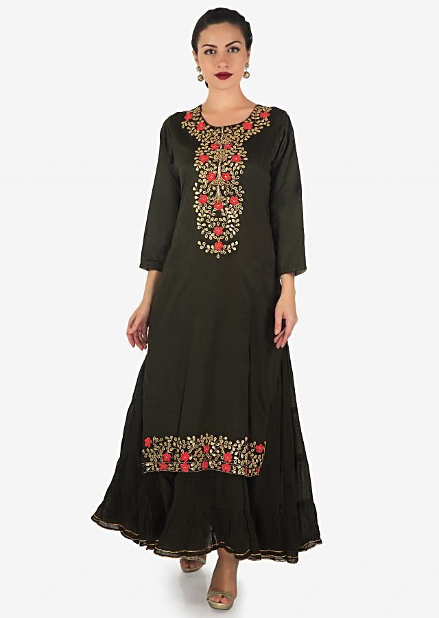 Dark green double layer dress in cotton embellished in fancy tassel and gotta patch embroidery only on Kalki