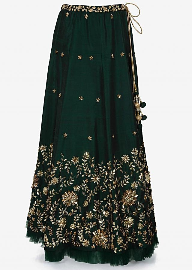 Dark green lehenga and blouse featuring in net with floral motif work only on Kalki