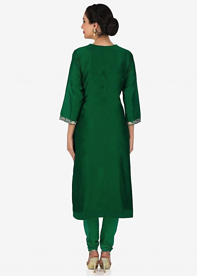 Dark green straight suit in silk with embroidered armhole only on Kalki