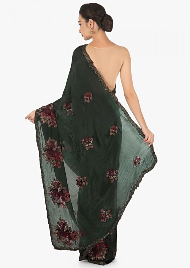 Dark olive green saree in crepe with resham embroidery in floral motif only on Kalki