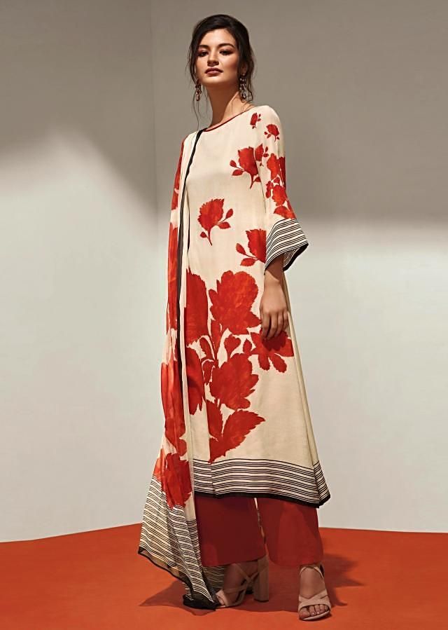 Dark orange and cream unstithced suit with floral pritned hem line and sleeveonly on Kalki