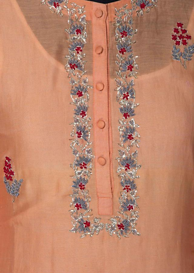 Dark peach and white kurti adorn in french knot embroidery only on Kalki