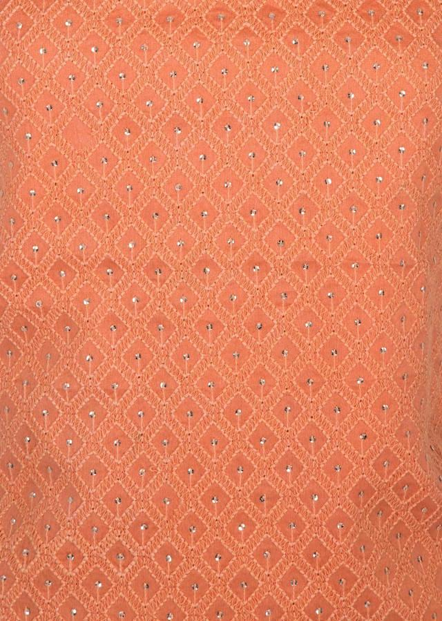 Dark peach unstitched suit beautified with thread work and moti work only on Kalki