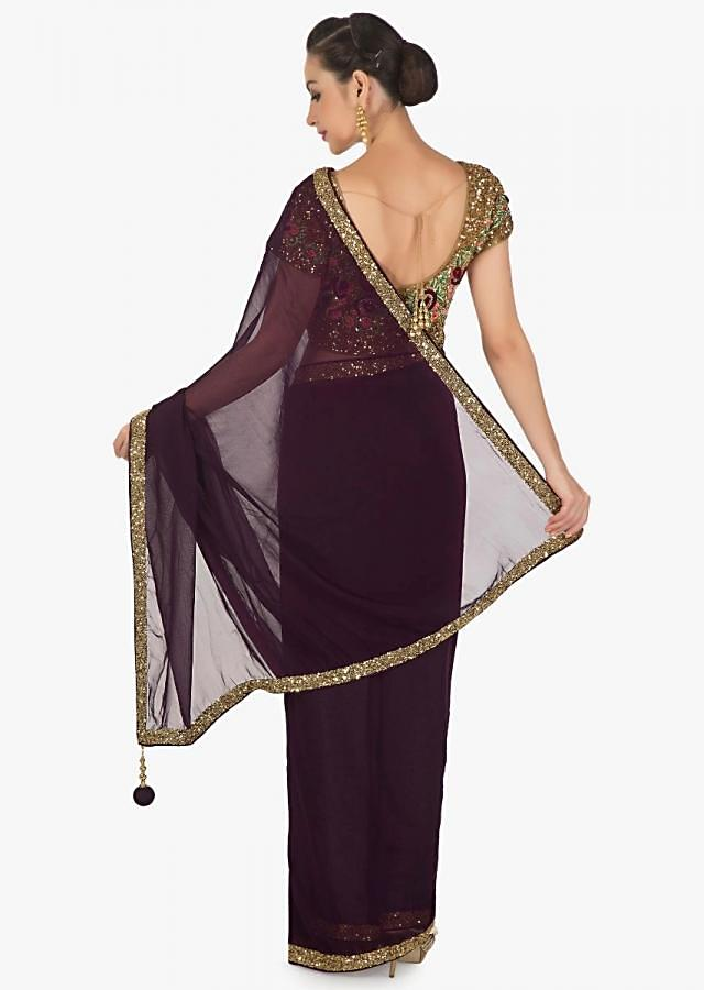 Dark purple saree in georgette with sequin border and ready embroidered blouse only on Kalki