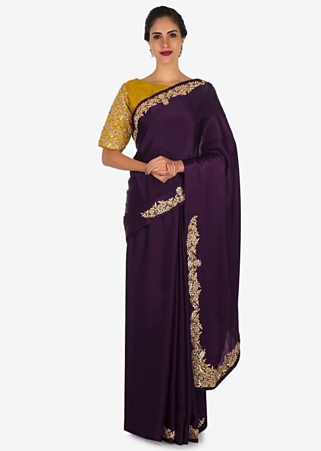 Dark purple saree in satin with mustard blouse beautified in zardosi and gotta patch work only on Kalki