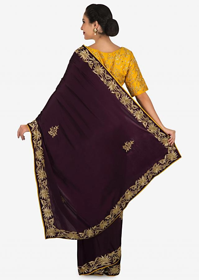 Dark purple saree with mustard blouse carved in heavy cut dana embroidery work only on Kalki