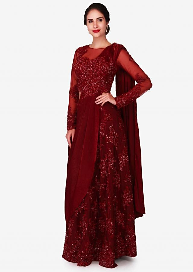 Dark red net pre-stitched gown saree featuring the resham and cut dana work only on Kalki