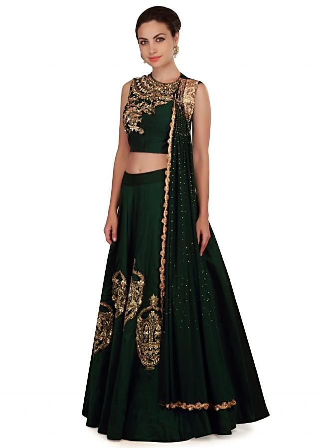Deep green lehenga with attached pleated dupatta only on Kalki