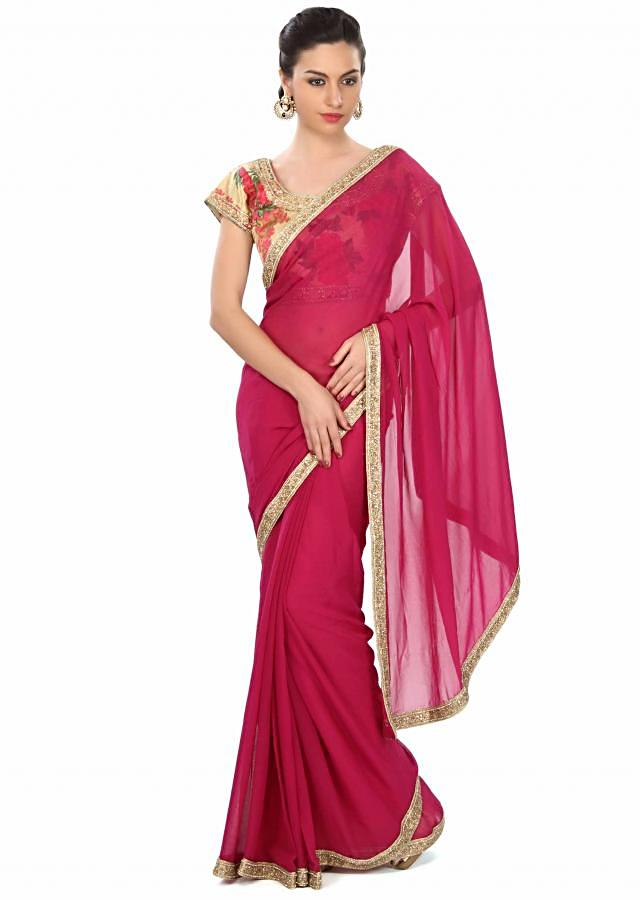 Deep pink saree enahcned in kundan embroidered border only on Kalki