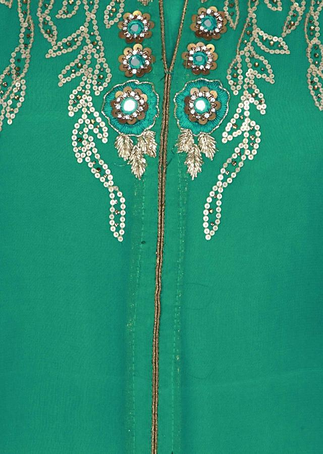 Deep green semi stitched suit adorn in sequin and mirror embroidery only on Kalki