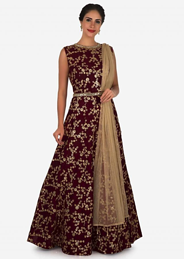 Deep maroon suit in raw silk embellished with zari and mirror embroidery work only on Kalki