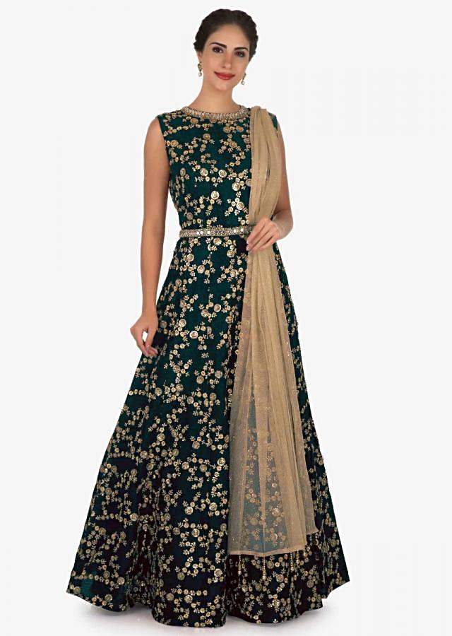 Green suit in raw silk embellished with zari and mirror embroidery work only on Kalki