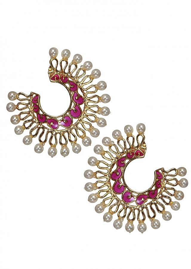 Delicate crescent shaped earrings with golden filigree work bordered with pearls.
