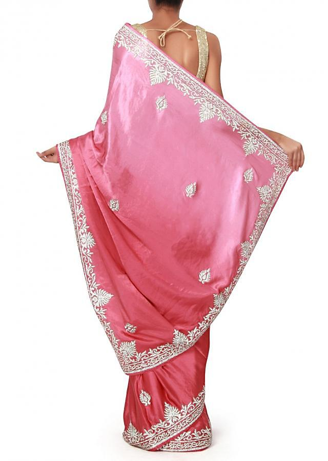 Desert pink shaded saree enhanced in stone embroidery only on Kalki