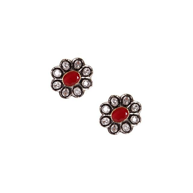 Diamond studs adorn with ruby center stone only on kalki
