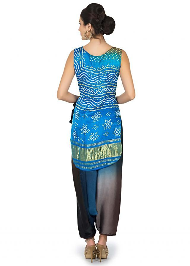 Diva blue satin top in bandhani print matched with Aladdin pants only on Kalki