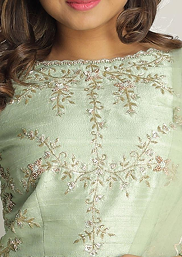 Dull Green Layered Lehenga With Embroidered Raw Silk Blouse Online - Kalki Fashion