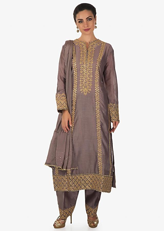 Dull grey A line suit with gotta embroidered neckline and hem only on Kalki