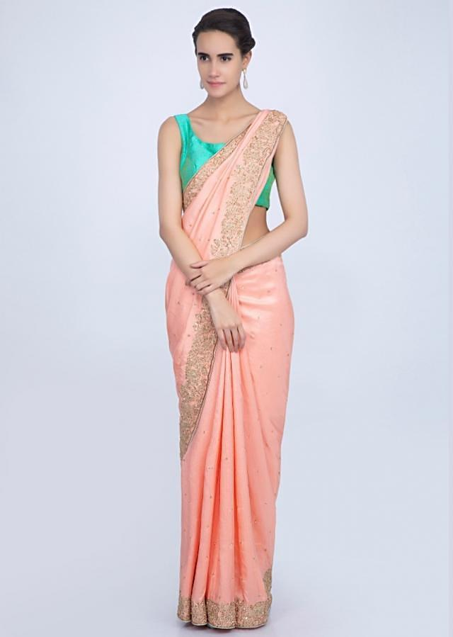 Dupion silk peach saree with scattered sequins and embroidered border only on Kalki
