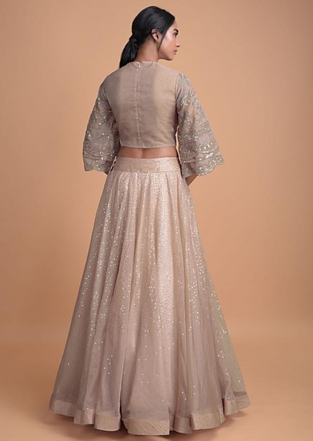 Dusty Pink Lehenga With A Bell Sleeves Embellished Crop Top And Ruffle Dupatta Online - Kalki Fashion
